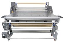 TitanJet RTX6M-1800BAU. Каландровый термопресс маслонаполненным барабаном с верхней загрузкой, ширина рабочей зоны – 1800 мм, диаметр барабана 350мм, в комплекте со столом и Автоматическим размоточным устройством, максимальная скорость - 3 м/мин. Автомати